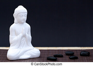 Meditation altar - White figure in meditation pose with...