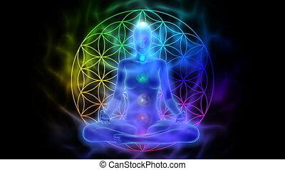 Animation of woman meditating - aura, chakras, symbol flower of life