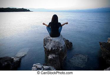 Meditation by the sea at dusk