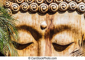 detail of a wooden zen sculpture in a zen garden