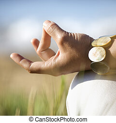Meditation hands. - Close-up of young adult Asian female's...