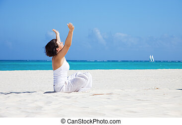 meditation on the beach - meditation of happy woman in lotus...