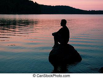 Meditation - man on rock