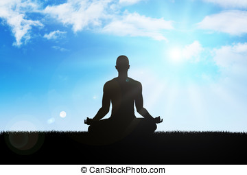 Meditation - Silhouette of a man figure meditating in the...