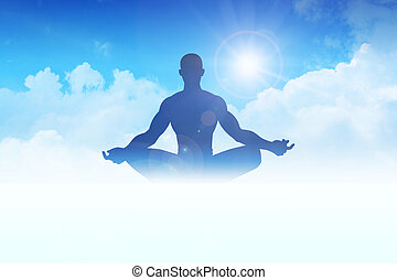 Meditation - Silhouette of a man figure meditating on clouds