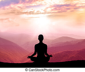 Meditation. Silhouette of man in the mountain