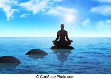 Meditation - Silhouette of a man figure meditating on a...