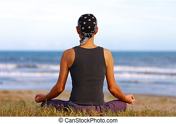 meditation - man sitting by the ocean and meditating calmly...
