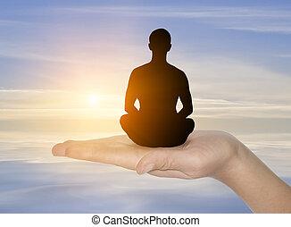 meditation - Silhouette of man and sunshine on sky...