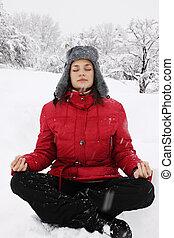 meditation winter - Woman meditating in the lotus position ...