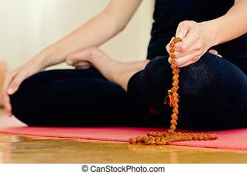 Meditation with rudraksha rosary beads