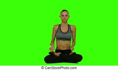 Meditation woman sitting lotus pose. Green screen