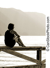 Meditation - Young girl looking at Crescent lake in Olympic...