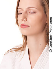 Meditation - Young woman sitting in white kimono eyes closed...