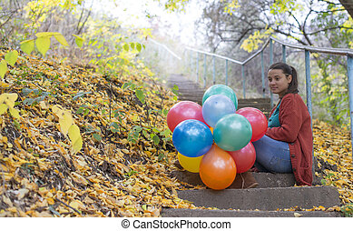Meditative girl with her balloons