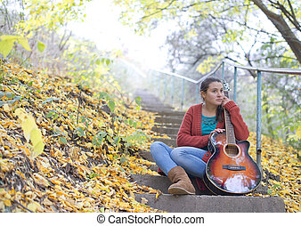 Meditative girl with her guitar