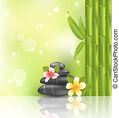 Meditative oriental background with frangipani, bamboo and heap stones, spa therapy