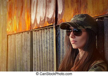 Portrait of a tough beautiful female army soldier