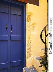 Mediterranean blue door with yellow wall