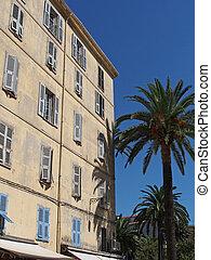 Mediterranean building and palm trees , Ajaccio, Corsica.