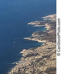 coastal aerial near Marseille with harbor under blue sky