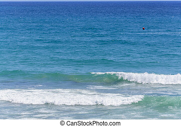Mediterranean colors azure blue ocean water and red buoy