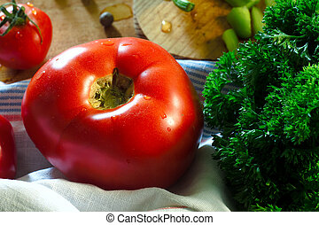 Tomatoes and parsley on wooden background