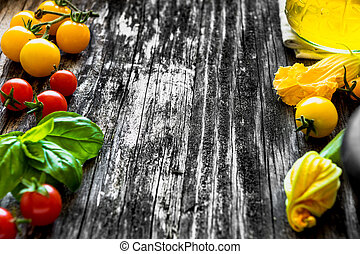 Mediterranean food ingredients on old wooden background