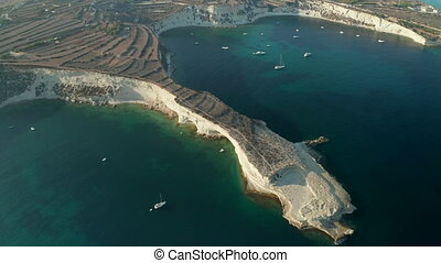 Mediterranean Headland of Malta Island in Sunset light with turquoise blue water, Aerial slide right