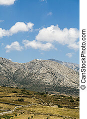 mediterranean landscape with mountains and fields and blue sky