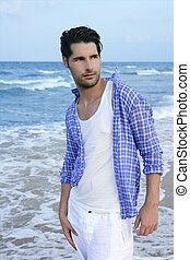 Mediterranean latin young man on beach