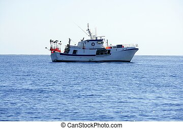 Mediterranean longliner boat working in Alicante to catch...