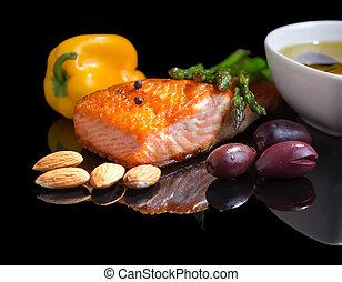 Mediterranean omega-3 diet. Fish steak, olives, nuts and ...