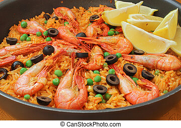 Mediterranean paella with shrimp, olives and green peas