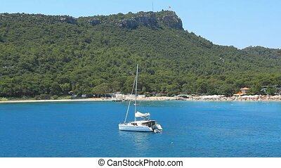 Mediterranean Sea and yacht in Kemer, Turkey