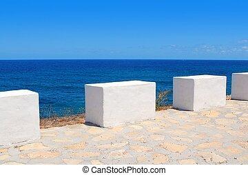 Mediterranean sea coastal view white milestones in Spain