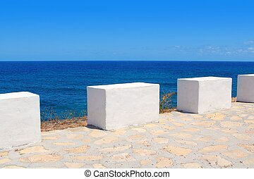 Mediterranean sea coastal view white milestones in Spain