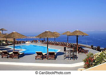 Mediterranean sea, pool and terrace in summer resort , Greece