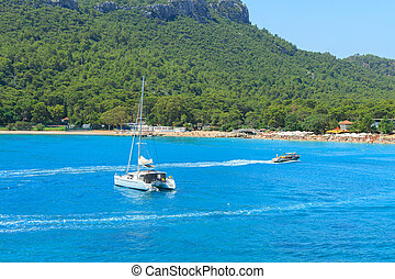 Mediterranean Sea with yachts and motor boat in Antalya