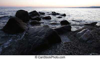 Mediterranean sunset and rocks