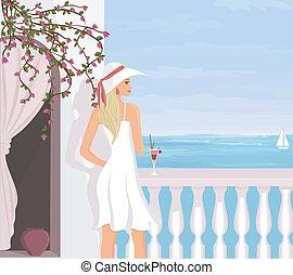 Mediterranean Vacation - A young beautiful woman is enjoying...