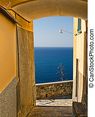 Mediterranean village and sea view, with agave plant -...
