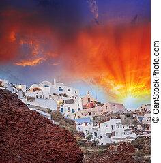 Mediterranean village of Oia at dusk, Santorini Island - Greece
