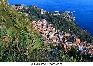 Mediterranean village in sicily (italy) called Taormina with...