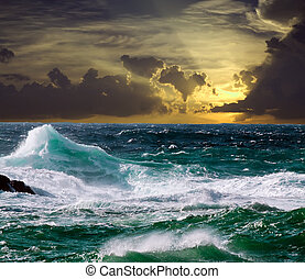 wave during storm in sunset time