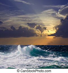wave during storm in sunset