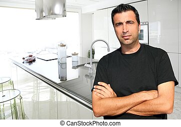 Medium age man in modern kitchen interior portrait