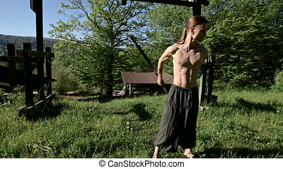 Medium Long shot Morning training of a long-haired man for a...