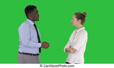 African american businessman explaining something to his collegue on a Green Screen, Chroma Key.