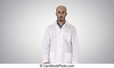 Arabian Doctor Talking to Camera on gradient background. -...